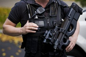 A Secret Service agent with the Counter Assault and Tactical Division holds a loaded weapon in front of the North Portico of the White House in Washington.